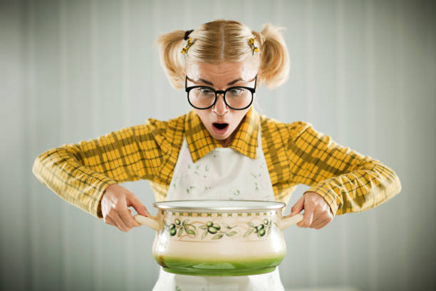 blonde geek holding cooking pot. - stupidblonde stock pictures, royalty-free photos & images