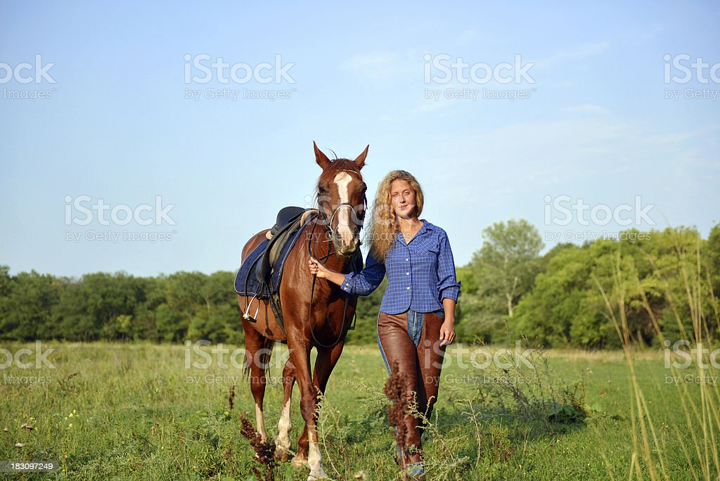 Blonde girl and her horse stock photo