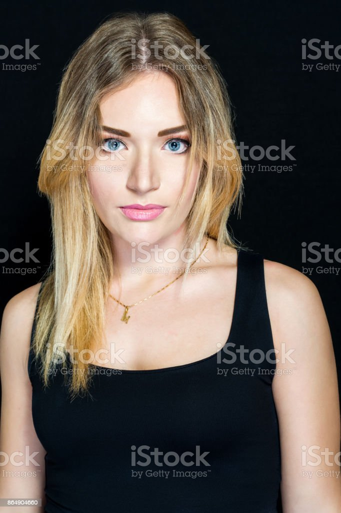 Blonde girl and make-up artist stock photo