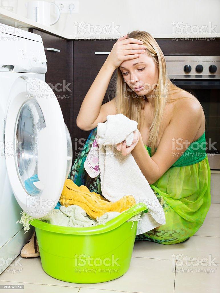 blonde girl and washing machine stock photo
