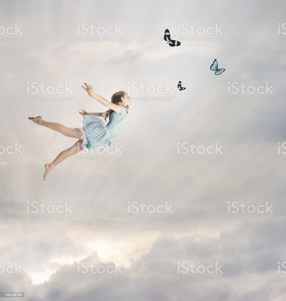 Blonde girl balanced in air with butterflies stock photo