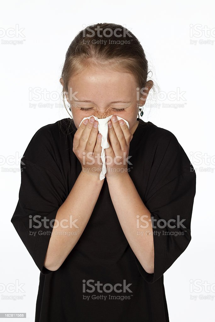 Blonde girl blowing her nose isolated on white. royalty-free stock photo