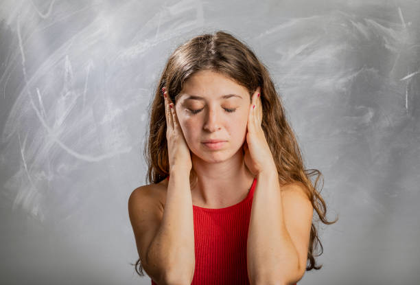 Blonde girl emotion and gesture portrait in studio hands covering ears Blonde girl emotion and gesture portrait in studio hands covering ears hands covering ears hear no evil teenage girls women stock pictures, royalty-free photos & images