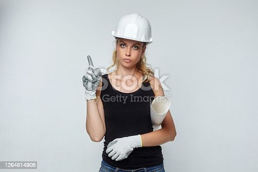blonde girl. in a white safety helmet indicates empty space for text. construction concept