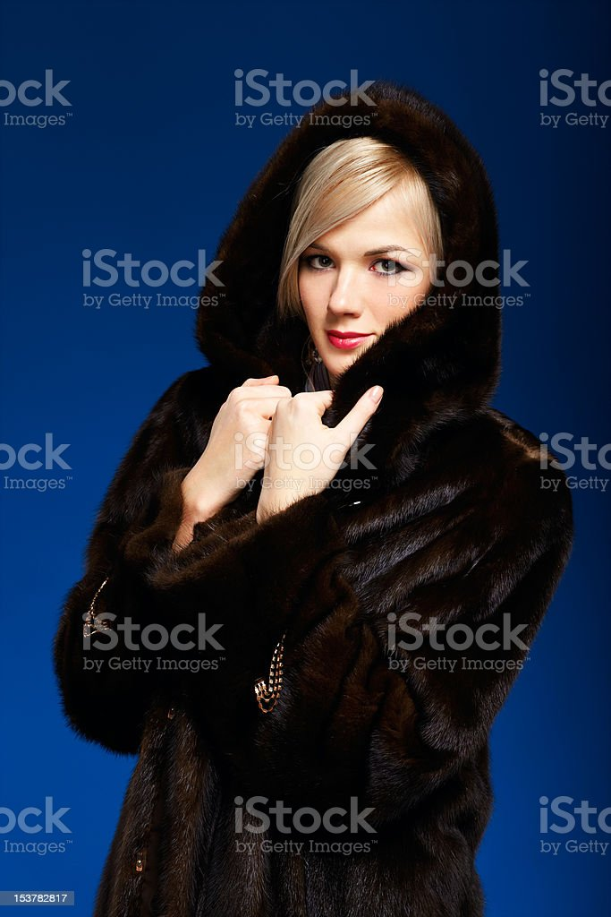 blonde girl in furs royalty-free stock photo