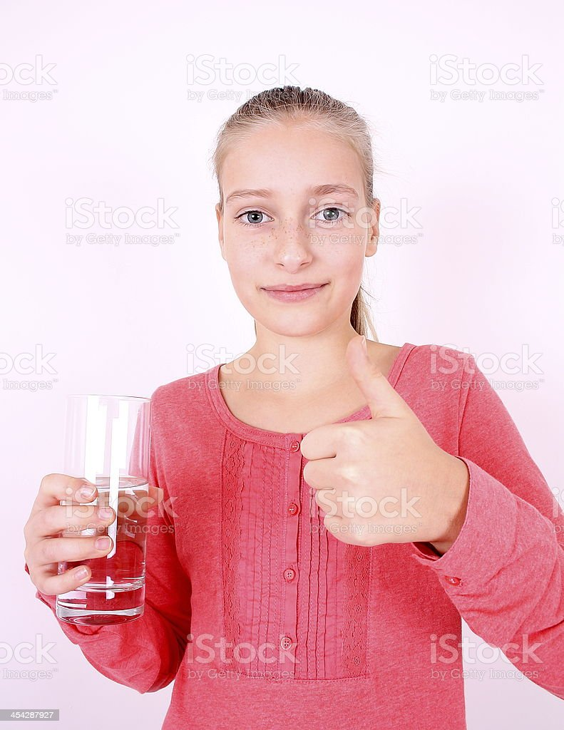 Blonde girl in pink drinks water with ok royalty-free stock photo