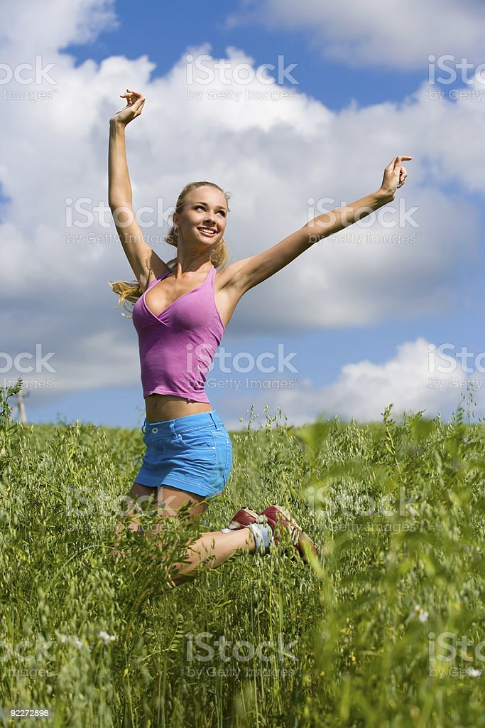 Blonde girl in the meadow royalty-free stock photo
