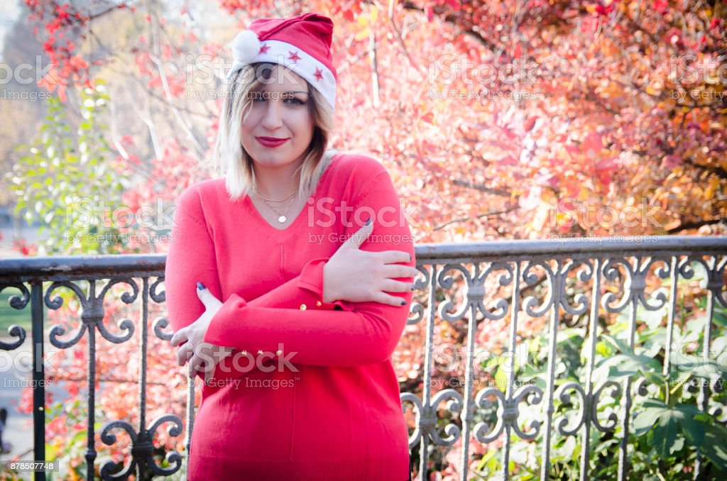 Blonde girl is freezing outside in christmas time stock photo