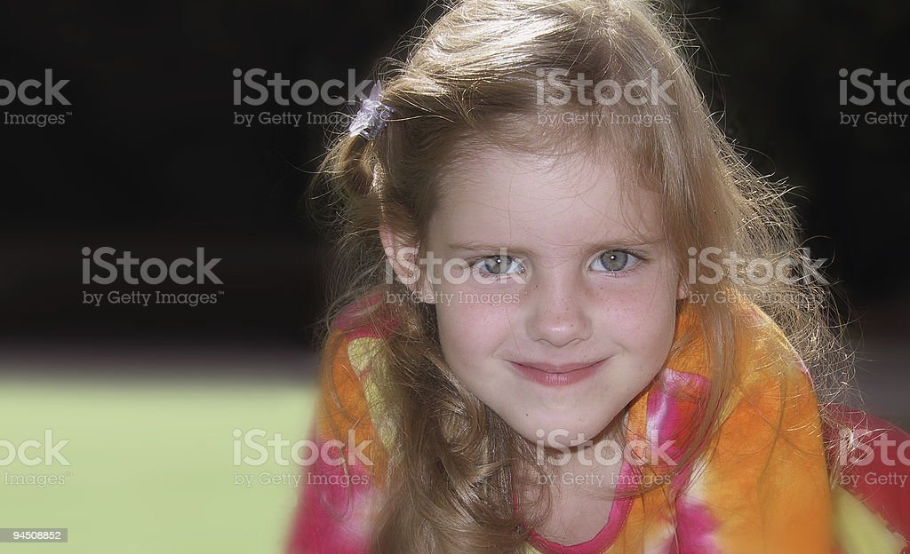 Blonde girl looking at you stock photo
