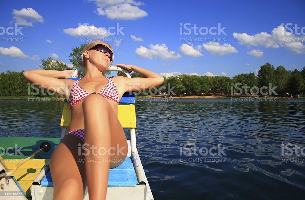blonde girl on catamaran royalty-free stock photo
