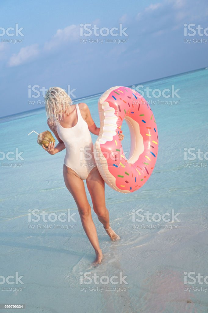 Blonde girl on vacation, Maldives stock photo