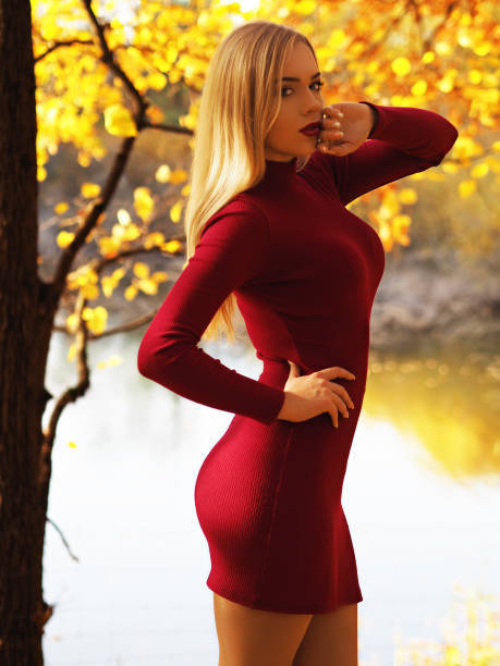 Blonde girl portrait at the autumn forest looking at camera Blonde girl portrait at the autumn forest looking at camera hot sexy butts stock pictures, royalty-free photos & images