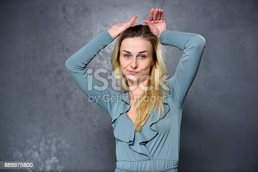 Blonde girl shows funny face