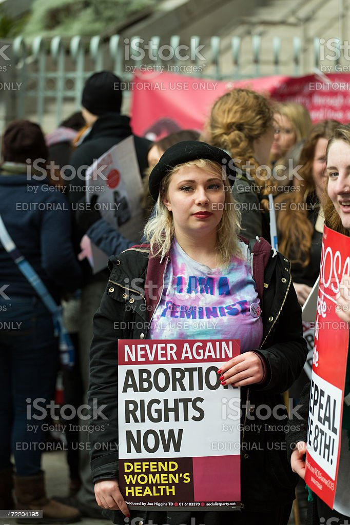Blonde girl protesting pro abortion rights stock photo