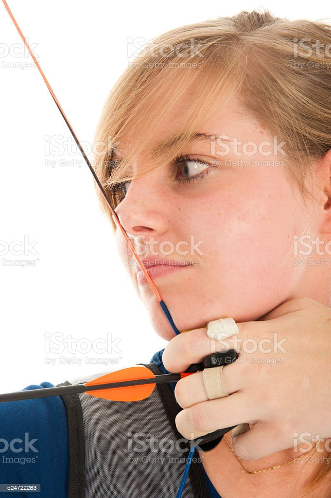 Blonde girl shooting with bow an arrow stock photo