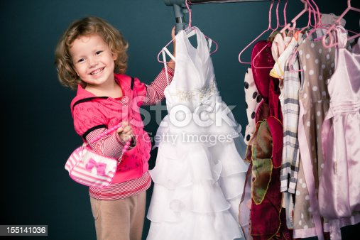 istock Blonde girl shopping for dresses while carrying little purse 155141036