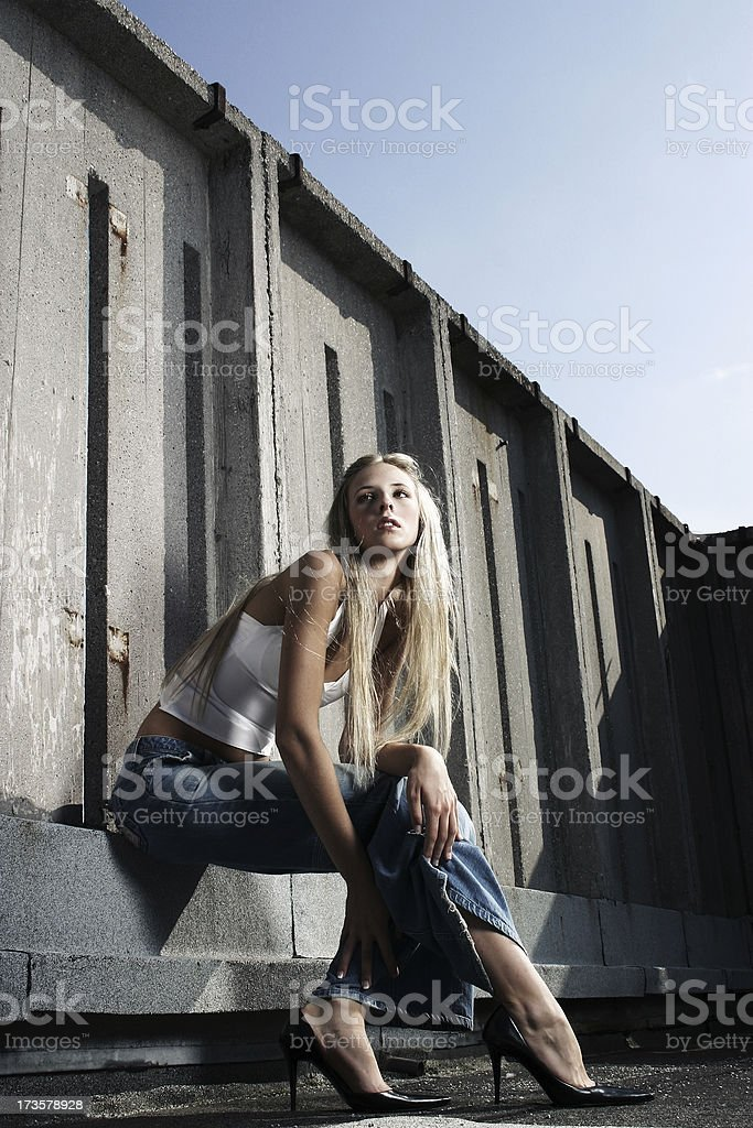 Blonde girl siting royalty-free stock photo