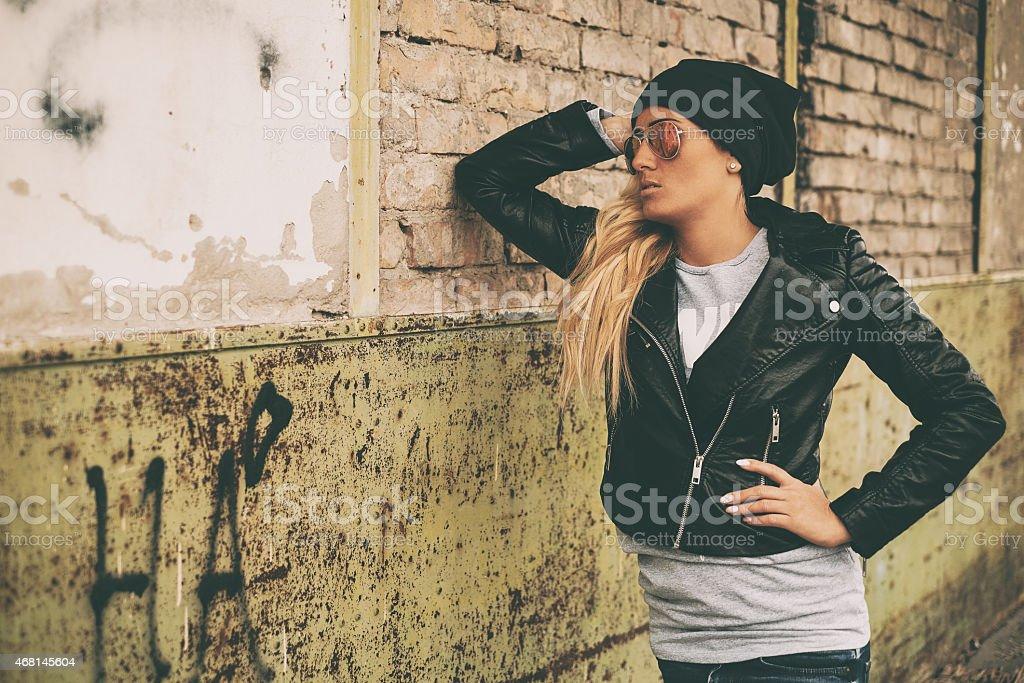 Blonde girl urban portrait stock photo