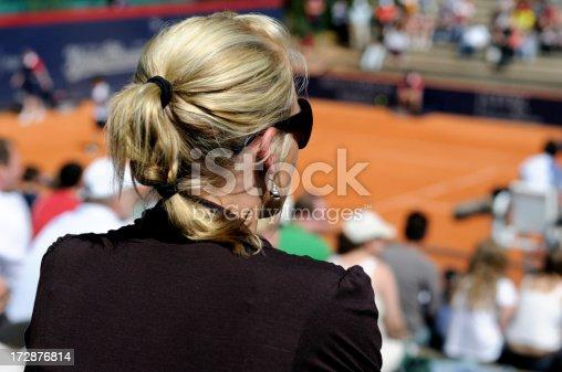 istock blonde girl watching tennis 172876814