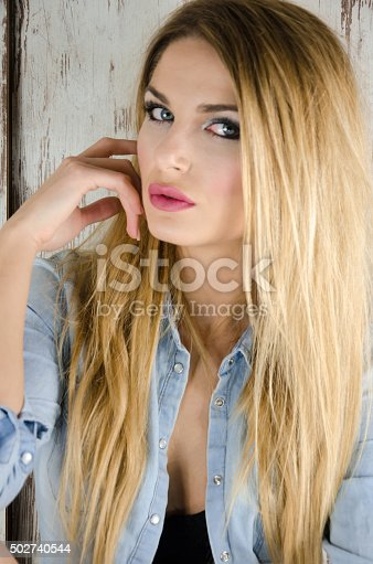 istock Blonde girl with a denim jacket 502740544