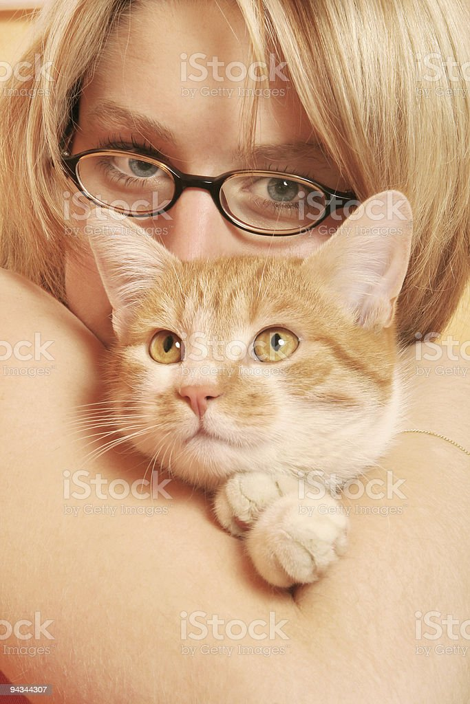 Blonde girl with cat royalty-free stock photo