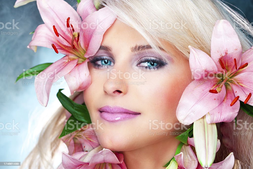 Blonde girl with flowers royalty-free stock photo