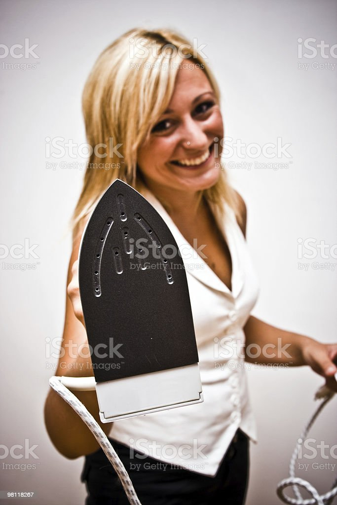 Blonde girl with iron royalty-free stock photo