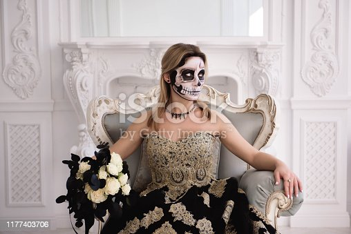 512061362istockphoto Blonde girl with sugar skull make. Day of Dead or Halloween 1177403706
