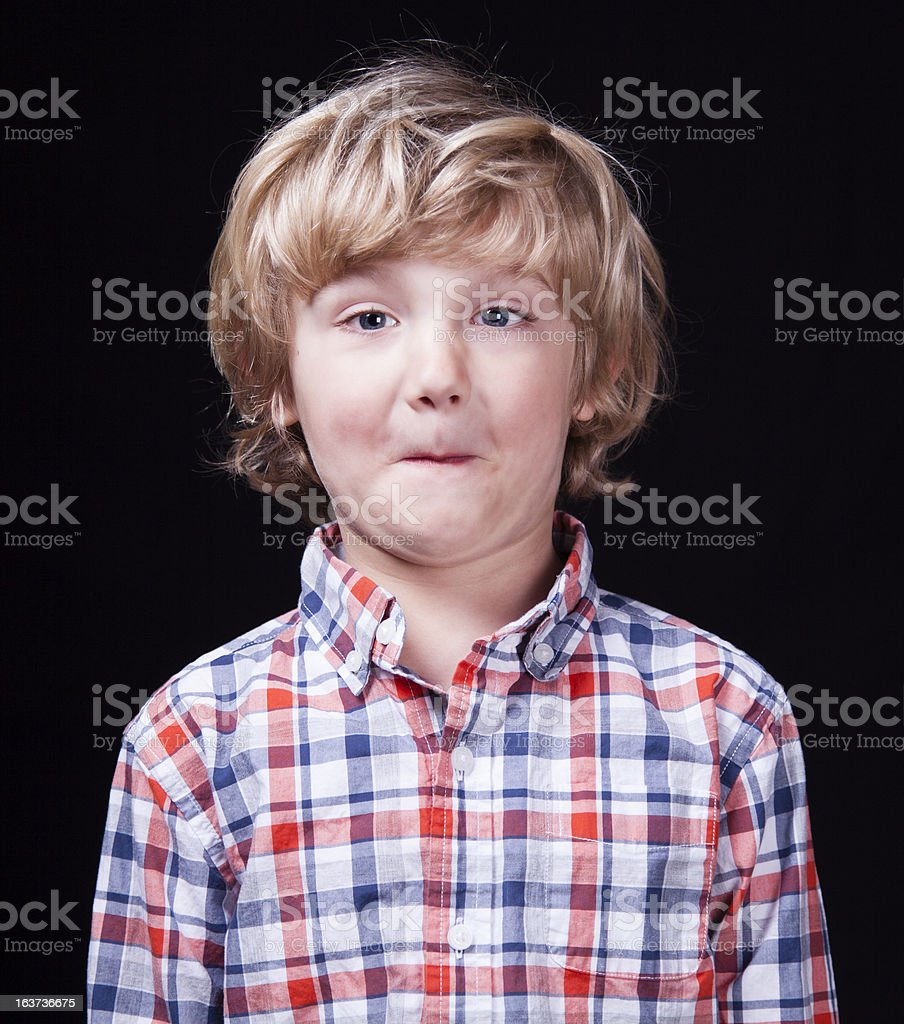 Blonde Hair Blue Eyed Boy With A Surprised Look Stock Photo IStock