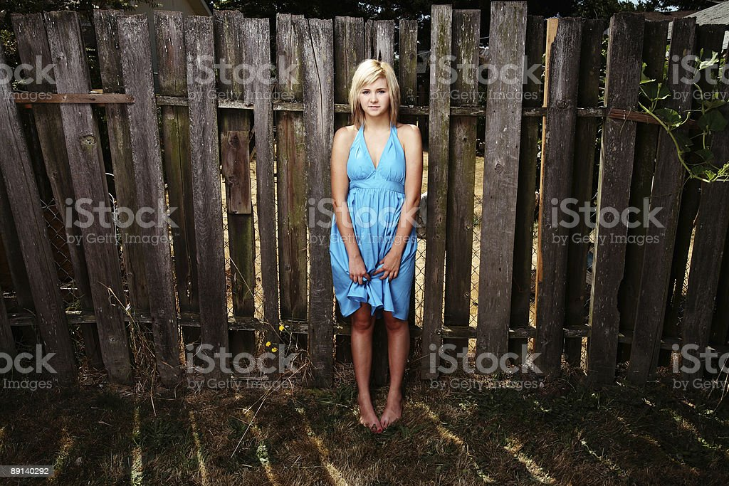 Blonde Holding a Dress royalty-free stock photo