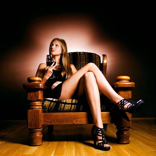 blonde in an armchair - mini dress stock photos and pictures
