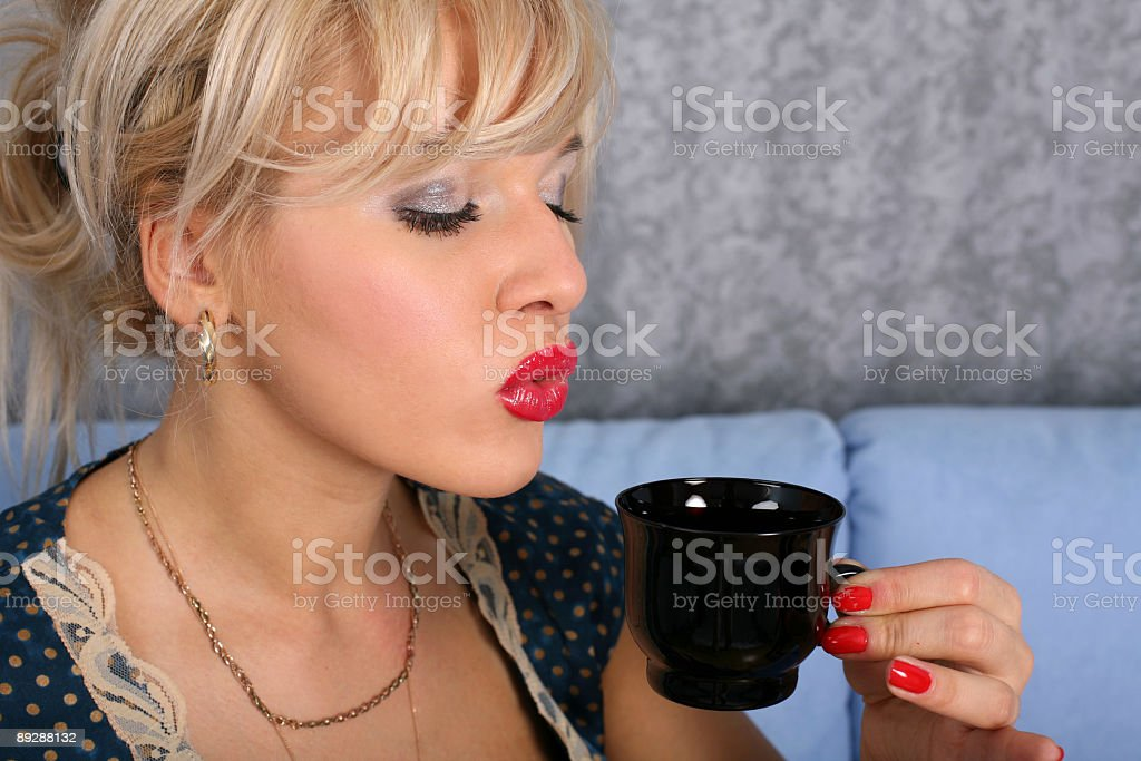 blonde in retro style posing with cup of tea royalty-free stock photo