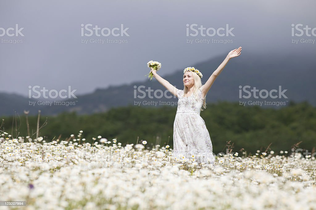 Blonde in wreath outdoors royalty-free stock photo