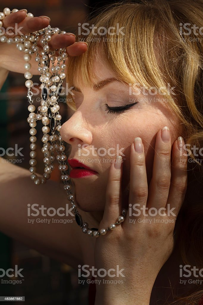 Blonde jewellery model with pearl necklaces stock photo