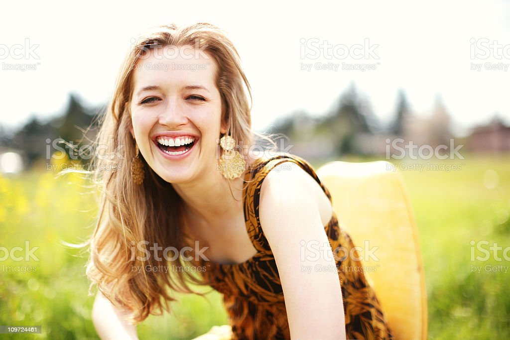 Blonde Laughing in the Sun royalty-free stock photo
