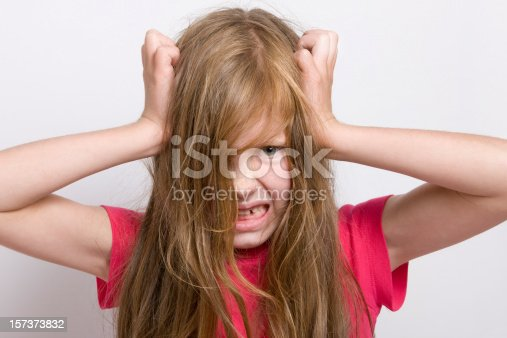 istock Blonde little girl tearing her hair out 157373832