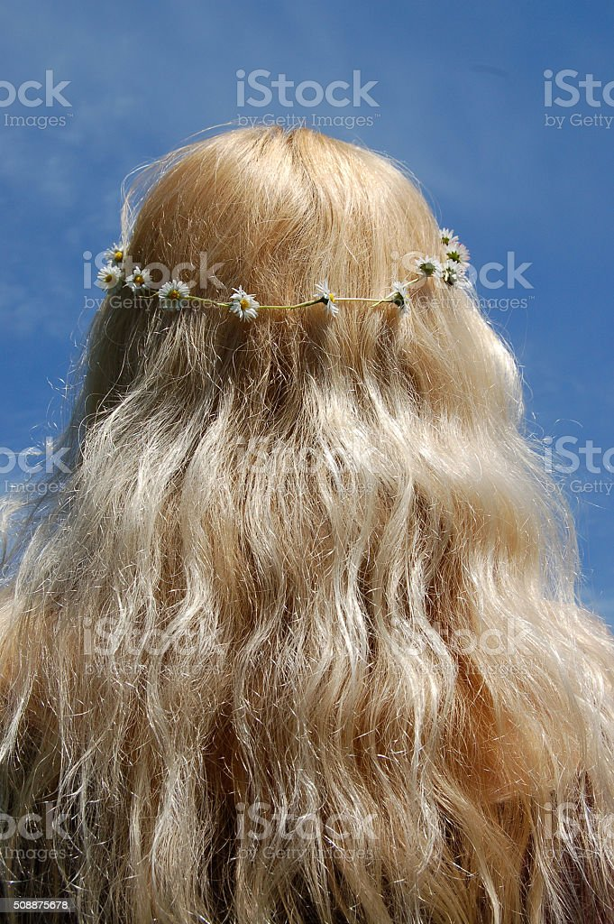 Blonde Long Haired Hippy Chick Girl in Daisy Chain stock photo