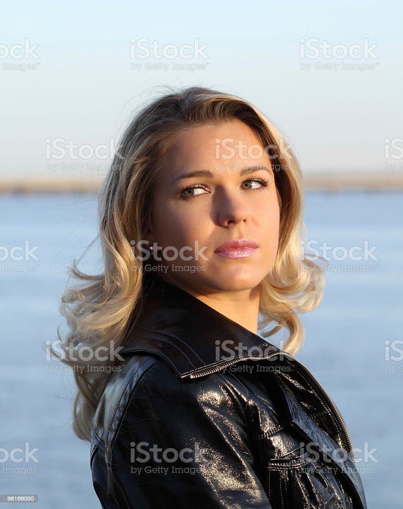 Blonde looks back at nature royalty-free stock photo