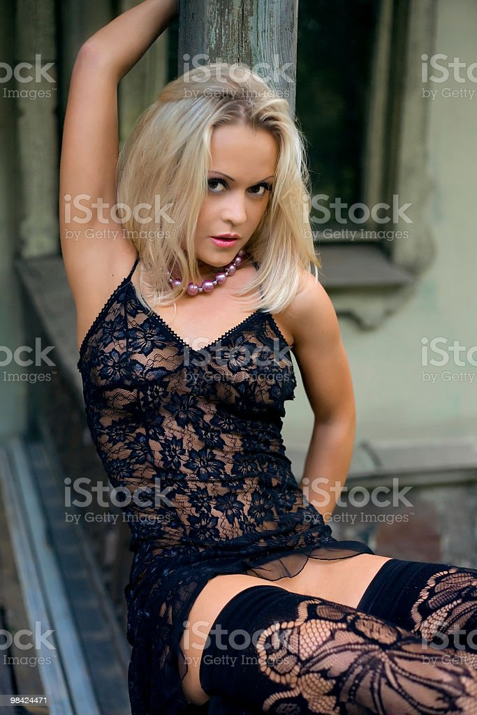 Blonde near the railing royalty-free stock photo