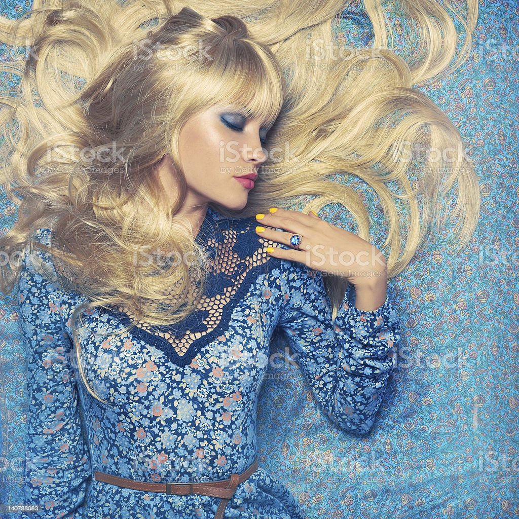Blonde on Blue royalty-free stock photo