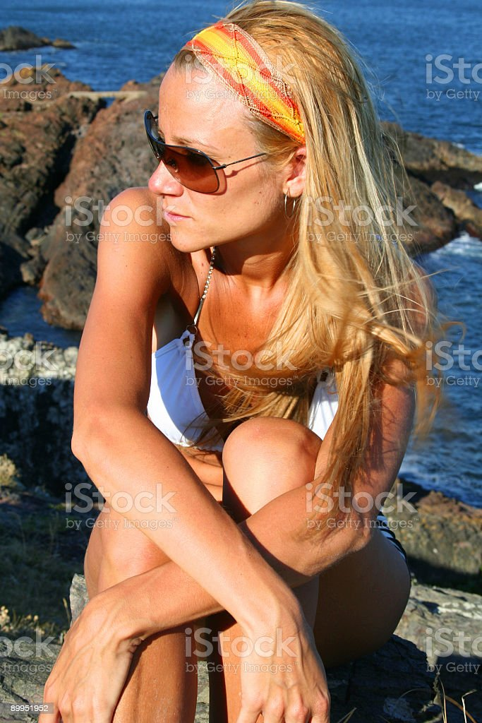 Blonde on the rocks royalty-free stock photo