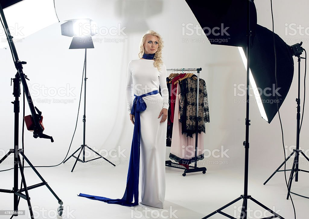 blonde posing against a professional studio royalty-free stock photo