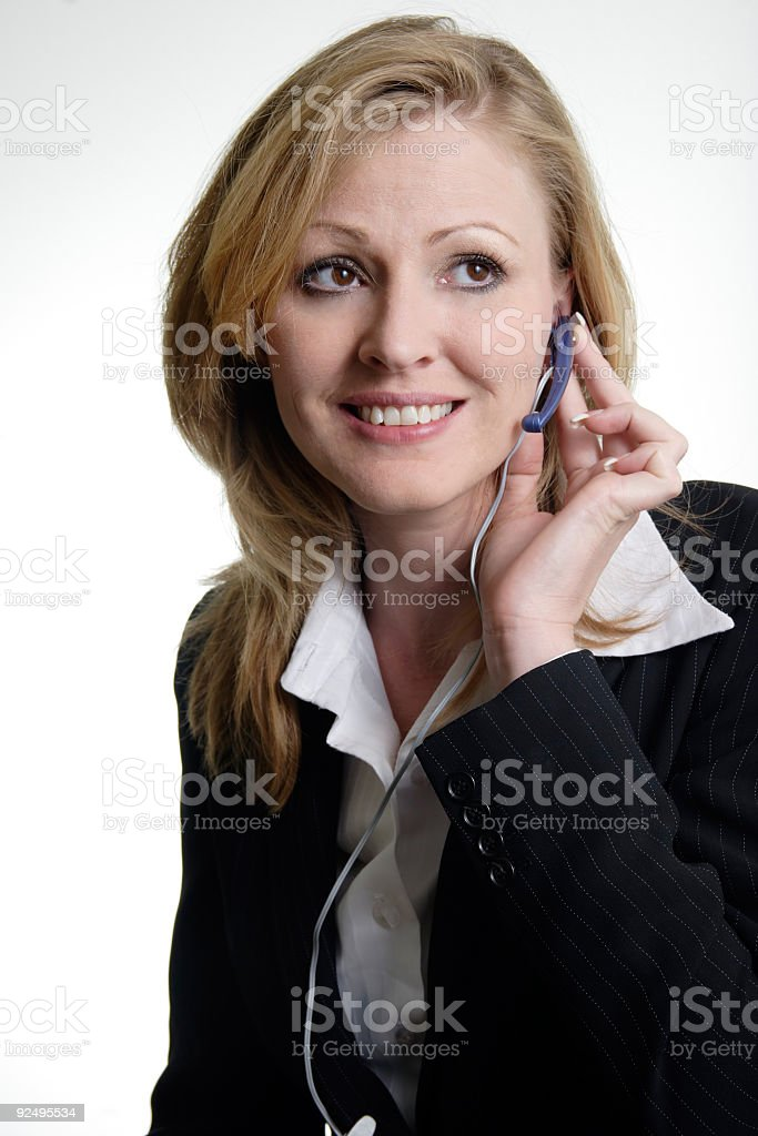 Blonde Receptionist wearing headset royalty-free stock photo