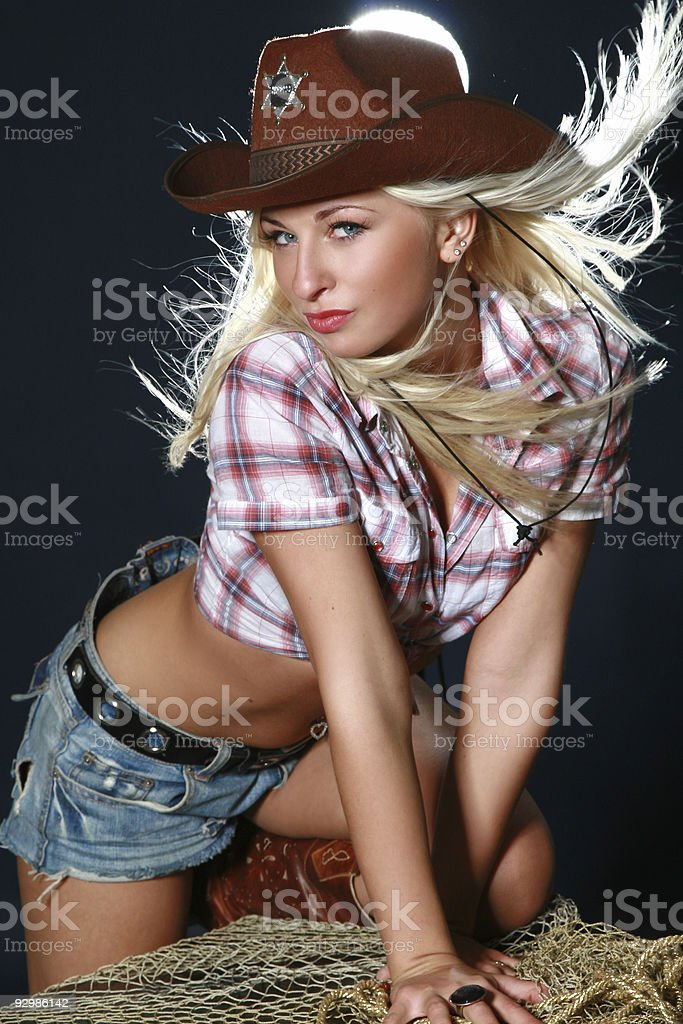 Blonde rodeo cowgirl wearing a cowboy hat stock photo