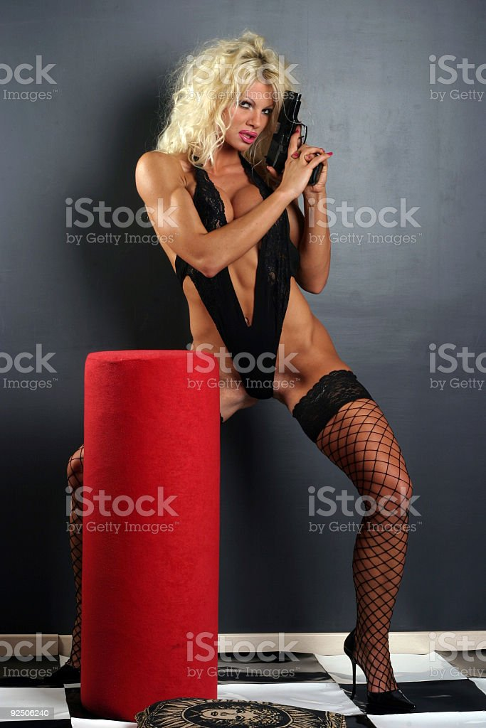 Blonde sexy girl with a Gun 04 royalty-free stock photo