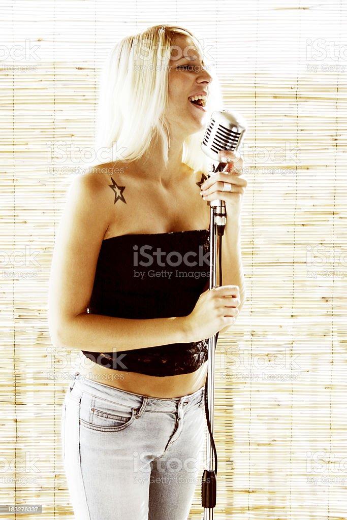 Blonde singer 1 royalty-free stock photo