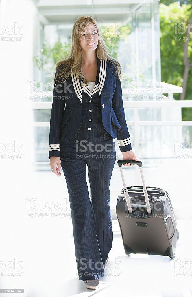 Blonde stewardess with suitcase royalty-free stock photo