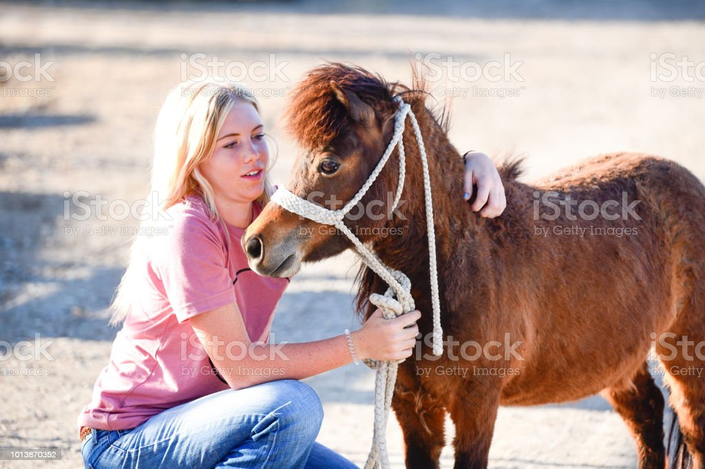Blonde Teenage Girl Hugs Her Miniature Pony In Spanish Fork Utah Usa