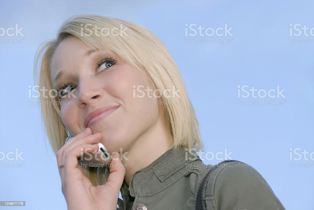Blonde Teenager Answering Her Cell Phone royalty-free stock photo