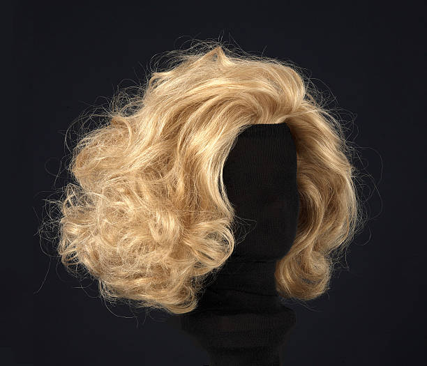 blonde wig isolated on black background blonde feminine wig on black background and textile mannequin. blond hair stock pictures, royalty-free photos & images